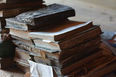 Old books. Old decaying forgotten books on desk stock photos