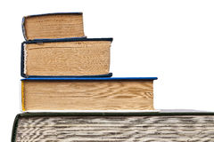 Old books. Of different sizes stacked in the form of a trapezoid Stock Photos