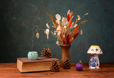 Old books and dried flowers Stock Image