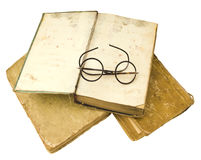 Old books with eye glasses Royalty Free Stock Photo