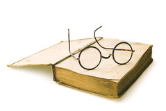 Old books with eye glasses Stock Photo