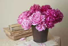 Old books and flowers. Old books, documents and peonies Stock Images