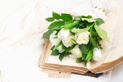 Old books with flowers royalty free stock photo