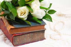 Old books with flowers stock images