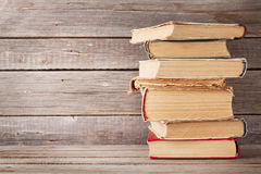 Old books. In front of wooden wall. With copy space royalty free stock photography