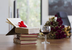 Old books with glass of wine Stock Image