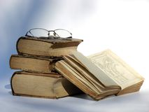 Old books and glasses. Old style vintage books with glasses on the top of them Royalty Free Stock Photo