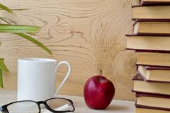 Old book and glasses on wooden shelf. stock image