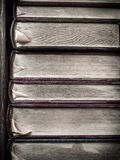 Old books. With gold leaf pages on shelf Stock Images
