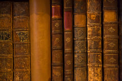 Old books. In a bookshelf Stock Images