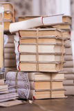 Old books heap in vintage library Stock Photo