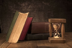 Old Books With Hourglass Stock Photography