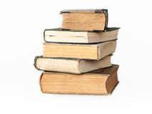 Old books isolated. Isolated pile of old books on a wooden table Royalty Free Stock Photo