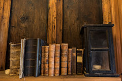 Old Books and Lantern on a Shelf Stock Photography