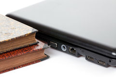 Old books and laptop Stock Photo