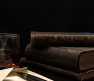 Old books and letter. Old books, the pen, the letter and serving of whiskey Royalty Free Stock Image