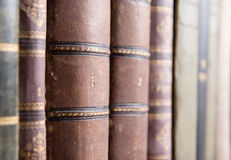 Old books in library. Row of aged books in library with focus on one book labeled as number one Stock Image