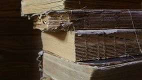Old books in the library archive. Turn over the old book with your hands. Read historical literature. Church archive.