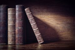 Old books on a library shelf background Royalty Free Stock Photos