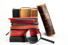Old books and magnifier royalty free stock image