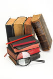 Old books and magnifier Stock Image