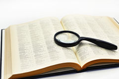 Old books with magnifying glass. Royalty Free Stock Photography