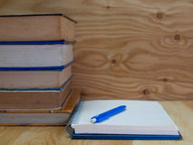 Old books , and notebooks. Placed on a wooden floor. (View with copy space royalty free stock images