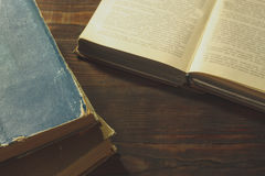 Old books on old wooden table. Dark tone Royalty Free Stock Photography