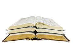 Old books open stacked research school isolated Royalty Free Stock Photos