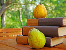Old books and pears outdoors Stock Image