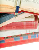 Old books and pen. Pile of old books and pen on white Royalty Free Stock Photo