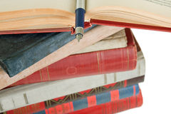Old books and pen. Pile of old books and pen on white Royalty Free Stock Photography