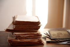 Old books and photos. Royalty Free Stock Images