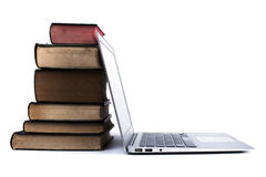 Old Books Pile and Laptop Royalty Free Stock Image
