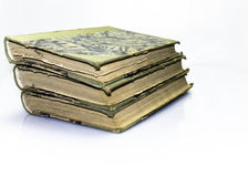 Old Books. Piled together over white background Stock Image