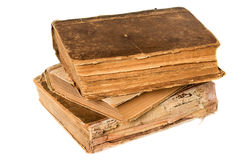 Old books piled together over white background Stock Photo