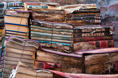 Old books. Piles of many old italian books in second-hand bookseller shop royalty free stock image