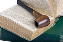 Old books and pipe Royalty Free Stock Photo