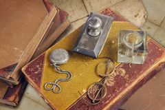 Old books with pocket watch royalty free stock images