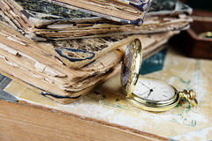 Old books and  pocket watch Stock Photo