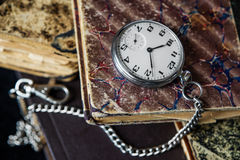 Old books and  pocket watch Royalty Free Stock Photos
