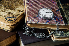 Old books and  pocket watch Royalty Free Stock Photo