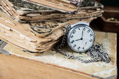 Old books and  pocketwatch Stock Photography