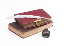 Old books and quill feather Royalty Free Stock Image