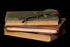 Old books and reading glasses Stock Photo