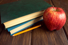 Old books and red apple Royalty Free Stock Photo
