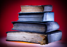 Old books, red light  background Royalty Free Stock Photo
