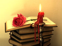 Old books, red rose... Stock Photos