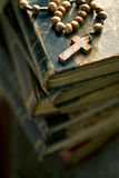Old books with rosary beads Stock Images