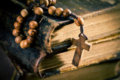 Old books with rosary beads Stock Photo